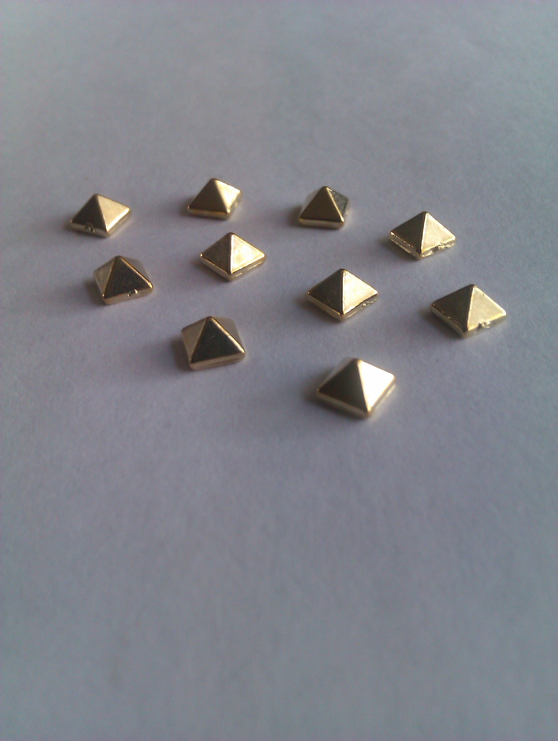 Pack of 10 gold pyramid spikes £1.00 http://www.charliesnailart.co.uk/pyramid-alloy-spikes-pk-of-10/