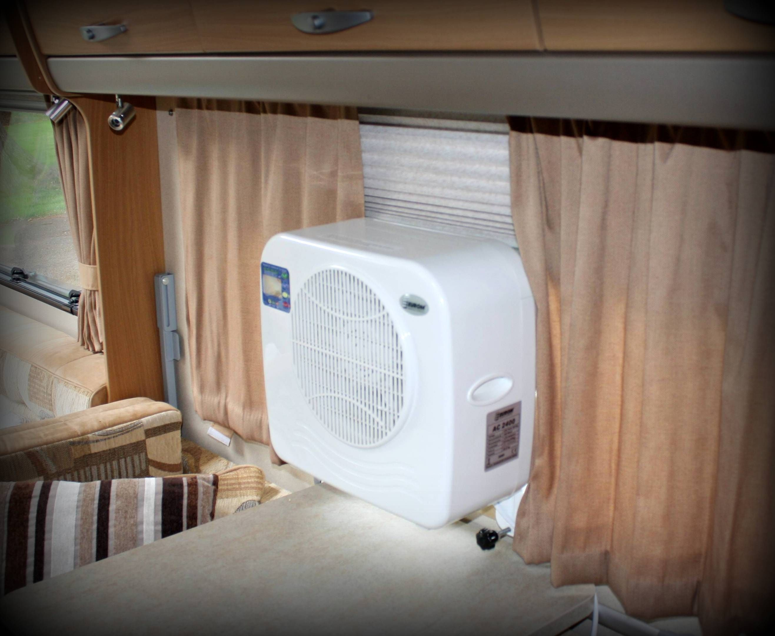Portable air conditioning unit shown inside Swift