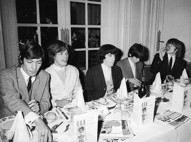 The Rolling Stones having dinner. At the Savoy Hotel in London on September 11th, 1964.