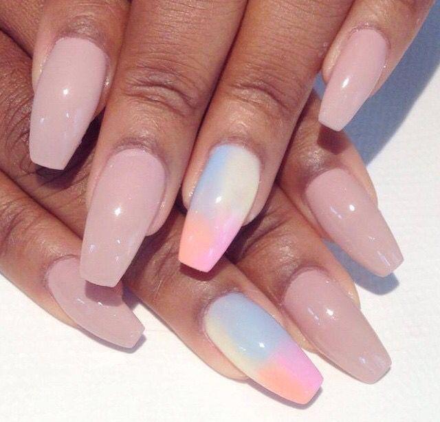 Nude nails with a rainbow splash nail
