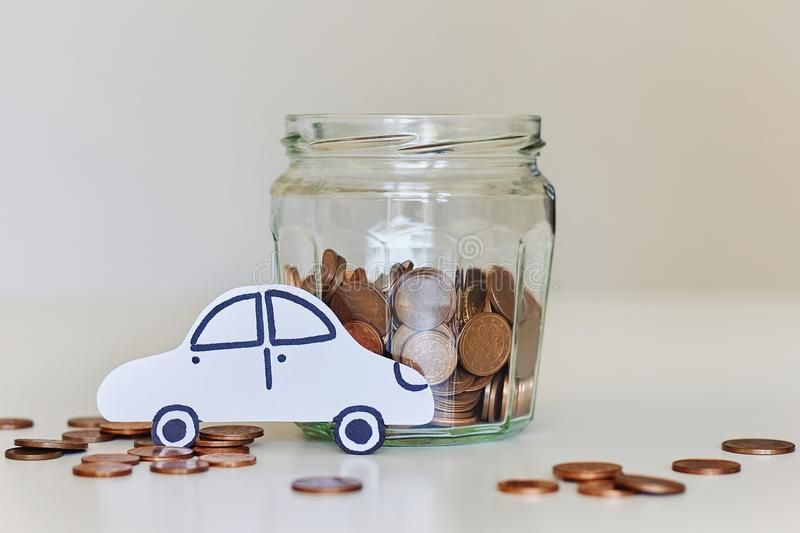 Car Loan Car Insurance Concept Glass Jar Full Of Coins And White Paper Car Ca Affiliate Insurance Concept C Glass Jars Paper Car Glass Storage Jars