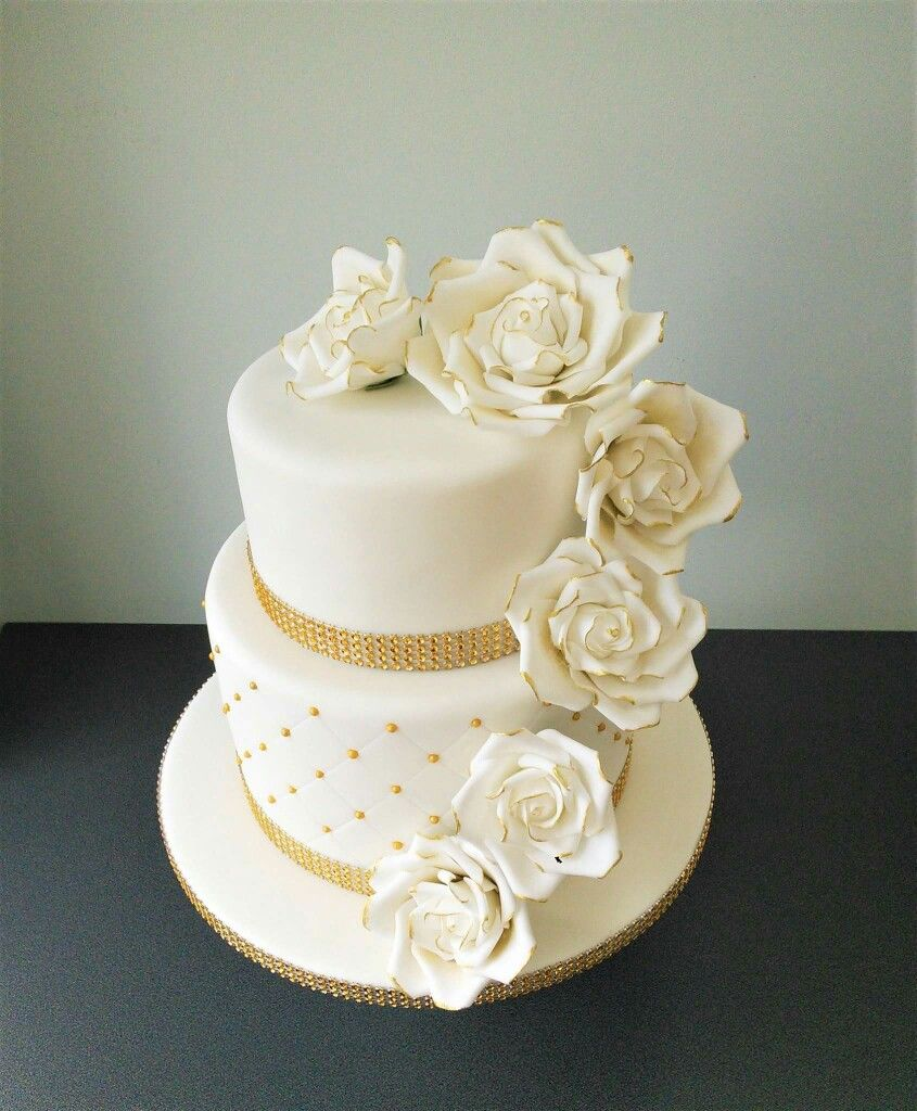Golden wedding two tier cake with white and gold roses Cakes