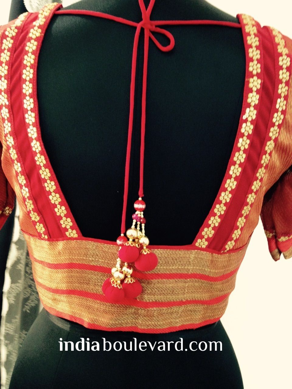 Hot off the sewing machine! A hot pink blouse with a sexy cut back studded with gold phulkari work and some beautiful droplets created by the team from scratch. Looks perfect when teamed with a plain gold sari or a mint green adding that contrast to your 'Desi Girl' look. Get your custom blouse at indiaboulevard.com or write to us at akta@indiaboulevard.com