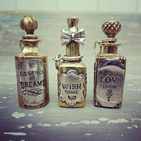 These bottles give me some ideas on using metallic paint paint and labels to dress up old jars.
