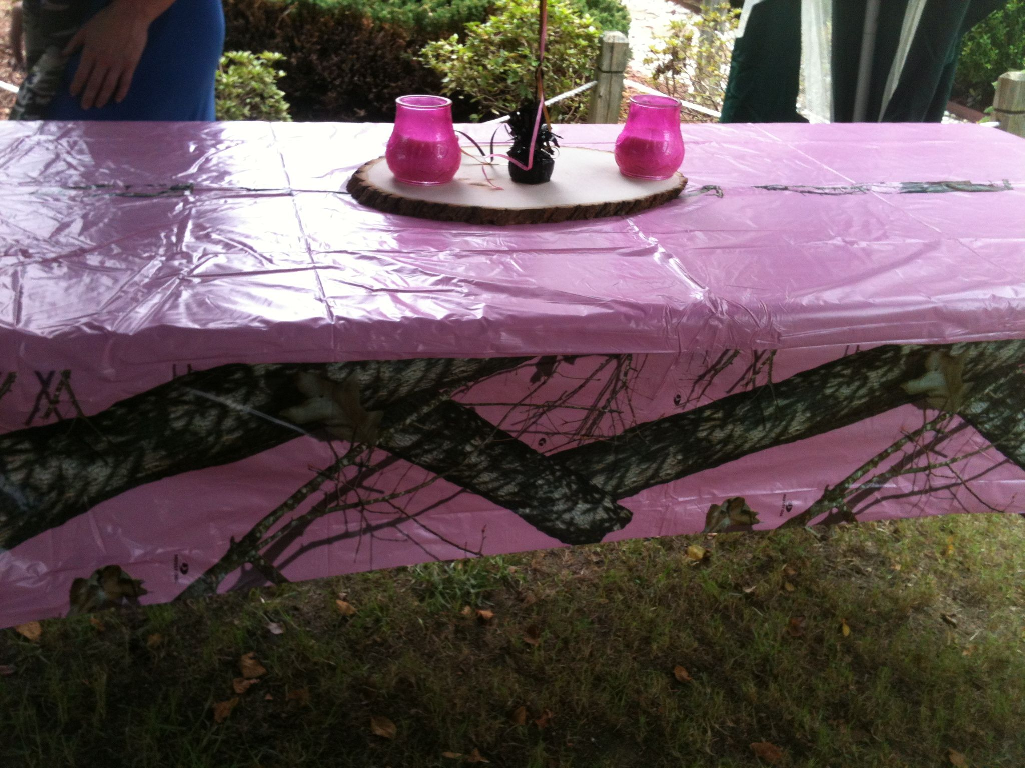 Pink Camo Table Cloth With Tree Slices As Centerpiece
