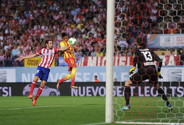 Neymar of Barcelona beats Juan Francisco Torres 'Juanfran' of Atletico Madrid to score  his team's opening goal during the Spanish Super Cup first leg match between Atletico de Madrid and Barcelona at Vicente Calderon Stadium on August 21, 2013 in Madrid, Spain.