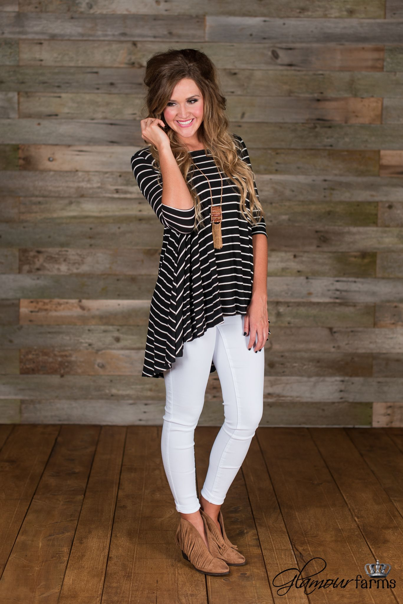 The Sadie Striped Tunic is right on trend. This striped tunic has a scoop neckline, 3/4 dolman style sleeves and a round hi-lo hem.