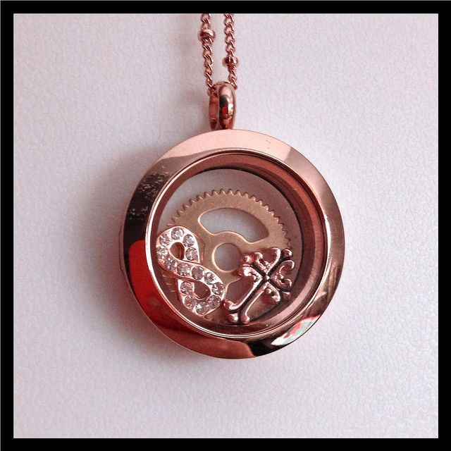 Origami Owl Living Locket - Medium rose gold locket, rose gold ball station chain, and three charms.  Visit laurajolley.origamiowl.com to place an order today!