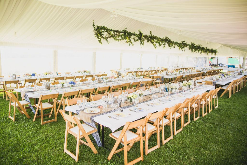 Marquee Structure Silk Lining Trestle Tables Wooden Padded Folding Chairs Weddings