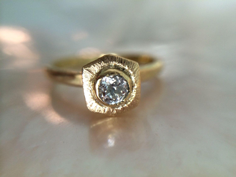 18kt Gold Halo Hexagon Diamond Engagement Ring- Geometric Conflict Free Diamond Gold Engagement Ring- Rustic Gold Engagement Ring by MelissaTysonDesigns on Etsy https://www.etsy.com/listing/201405121/18kt-gold-halo-hexagon-diamond