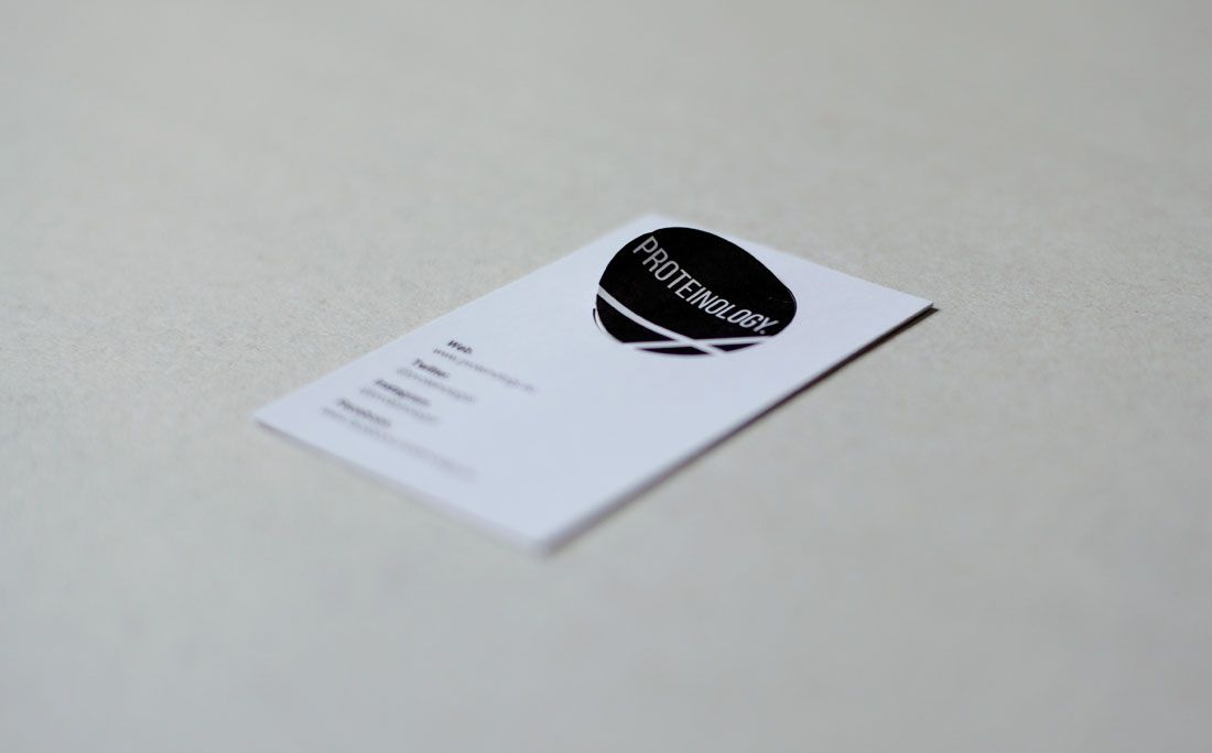 Proteinology business cards with a removable sticker
