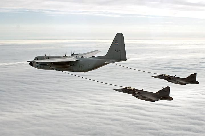 Two hungry Gripen from SwAF get their jet fuel from a Swedish C-130 Hercules tanker