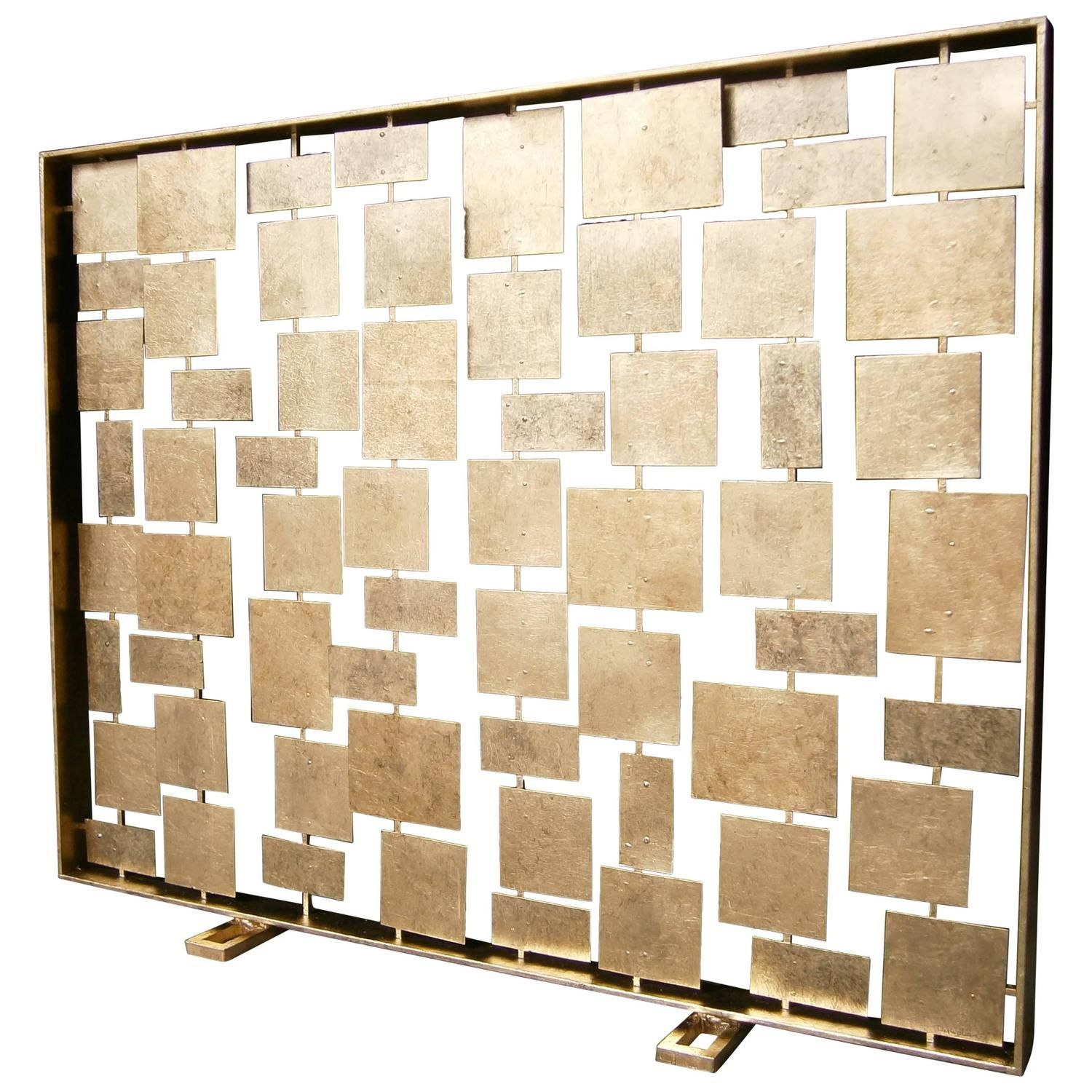 forms a contemporary gilded metal fire screen by american artist
