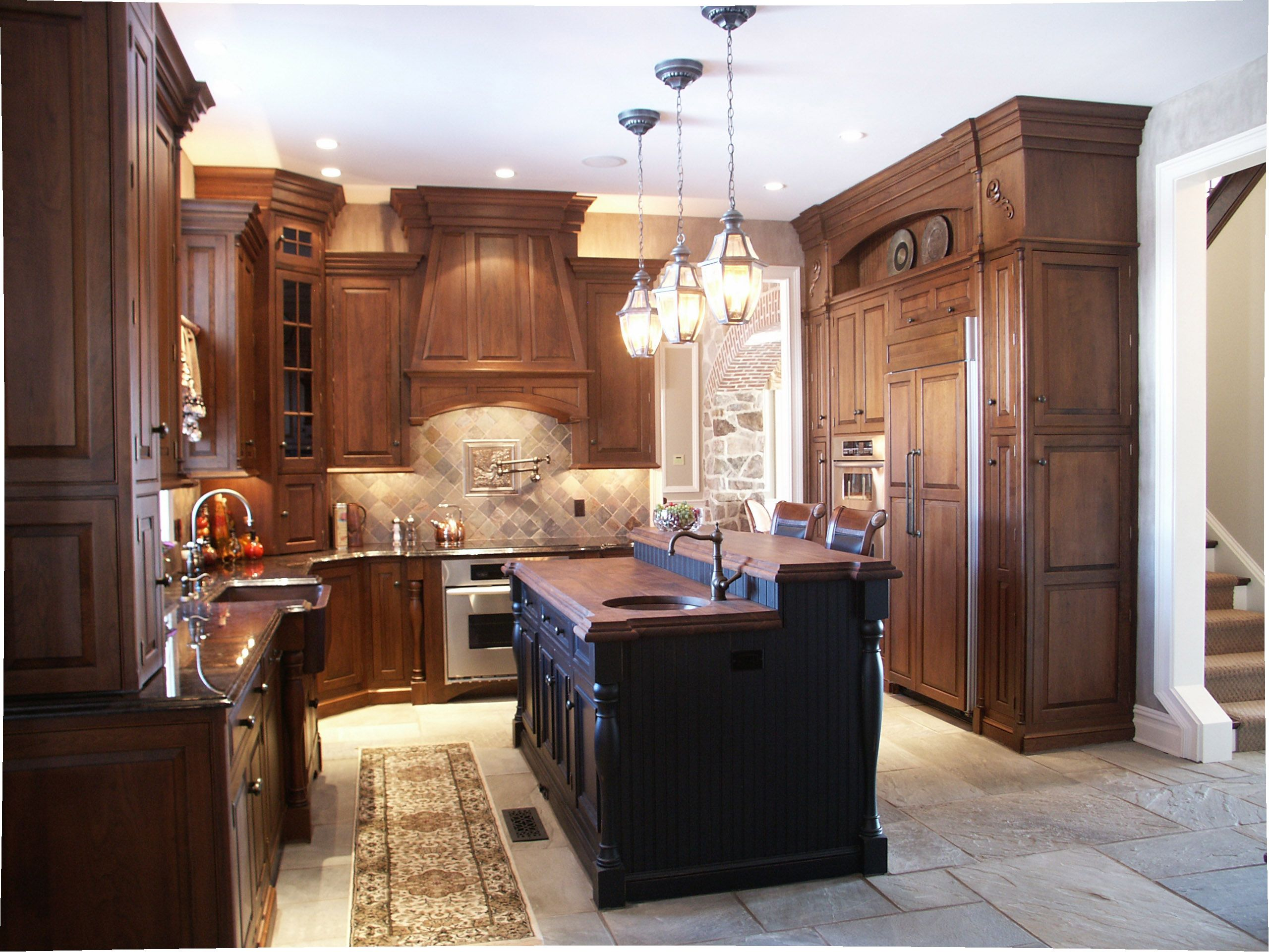 Old World Kitchen includes wall cabinets to the ceiling custom wood