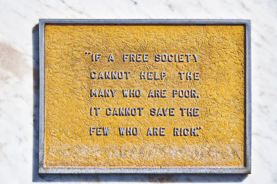 """Plaque: """"If a free society cannot help the many who are poor, it cannot save the few who are rich."""""""