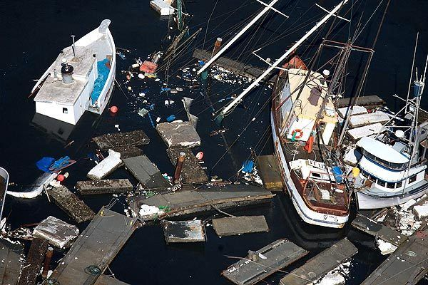 Boats and debris litter the harbor in Crescent City.