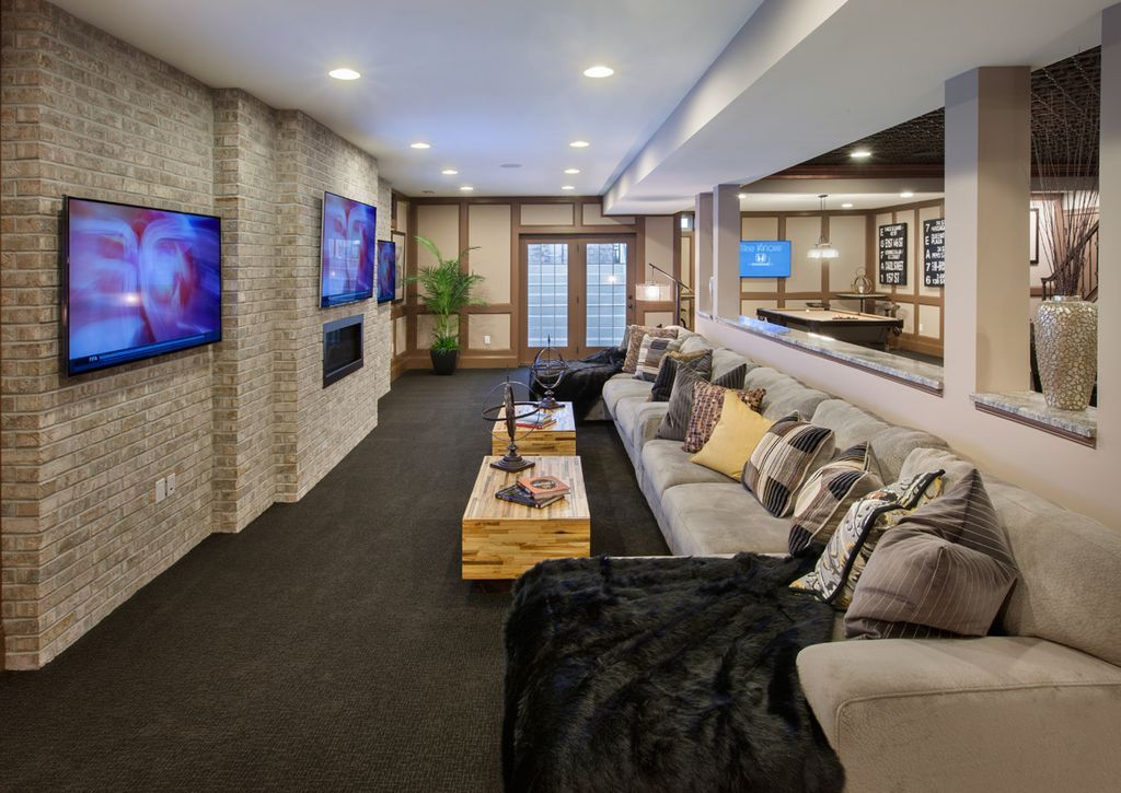 Contemporary Home Theater With Carpet, High Ceiling, Columns, Interior Brick