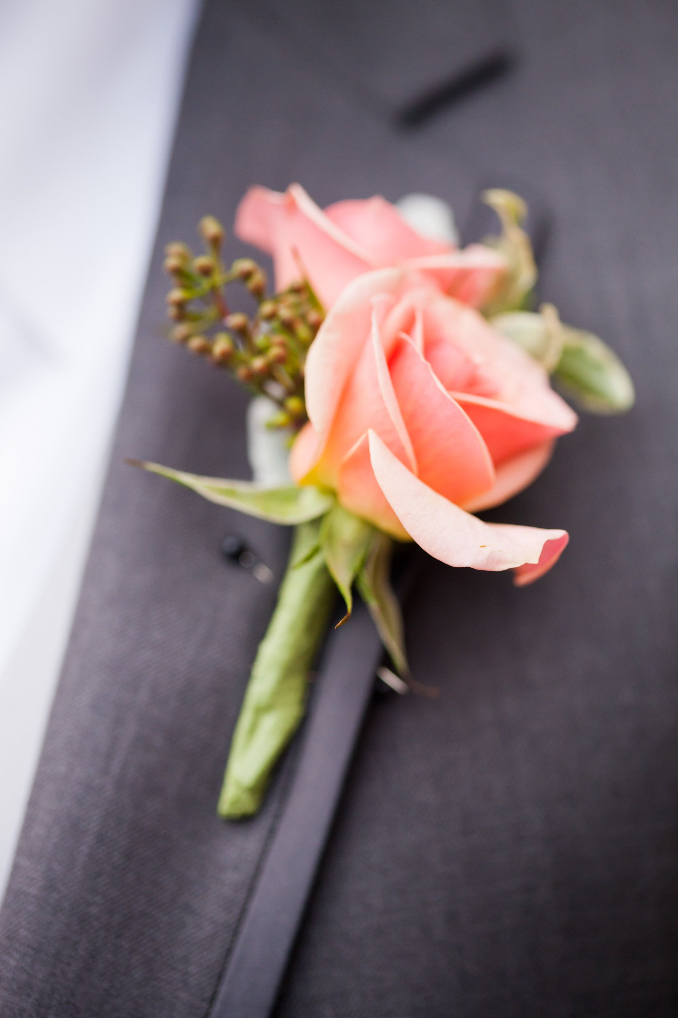 soft coral spray roses for the mens lapel