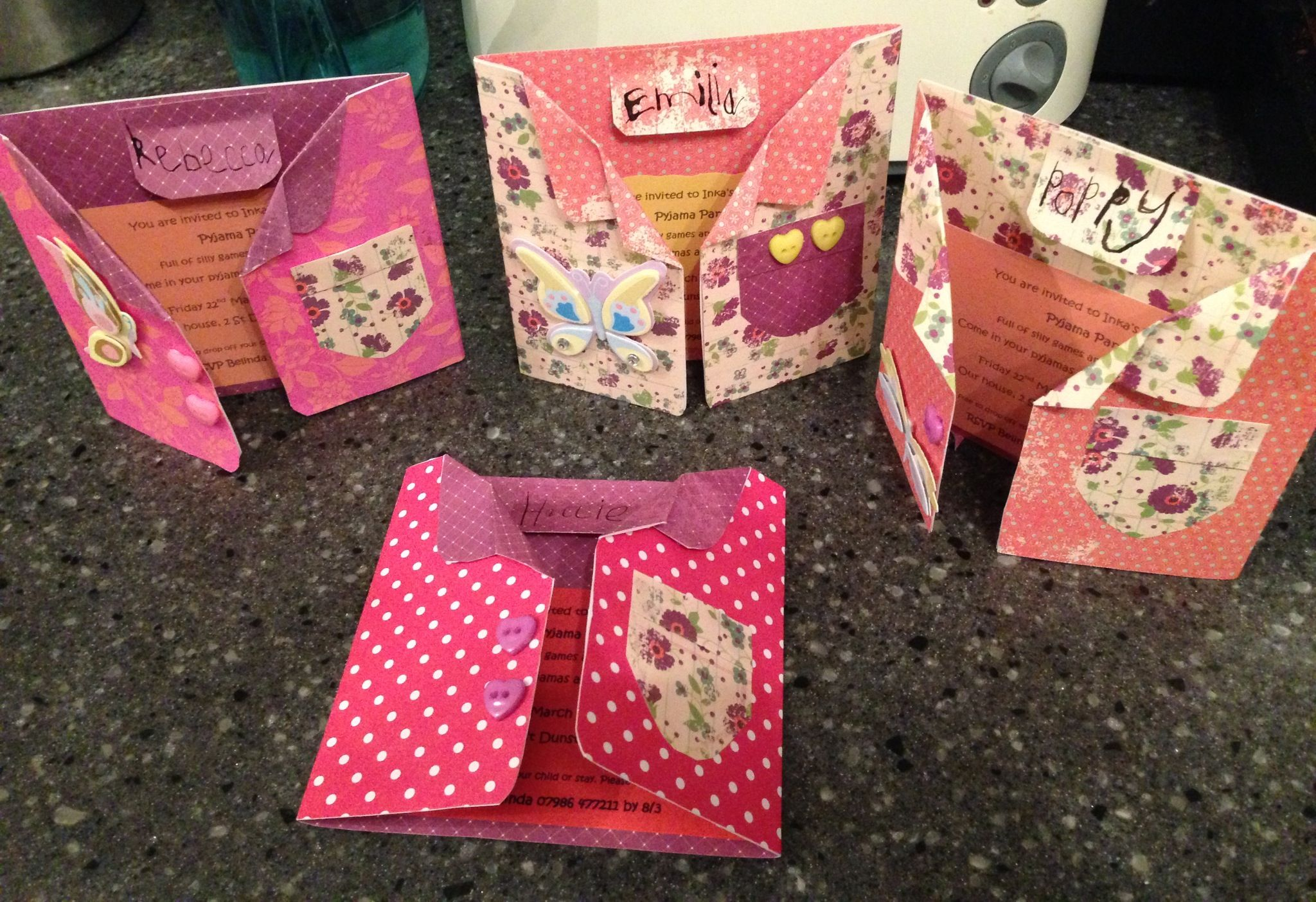 Pyjama party invitations. Folded collars and a tag is the invitees name.