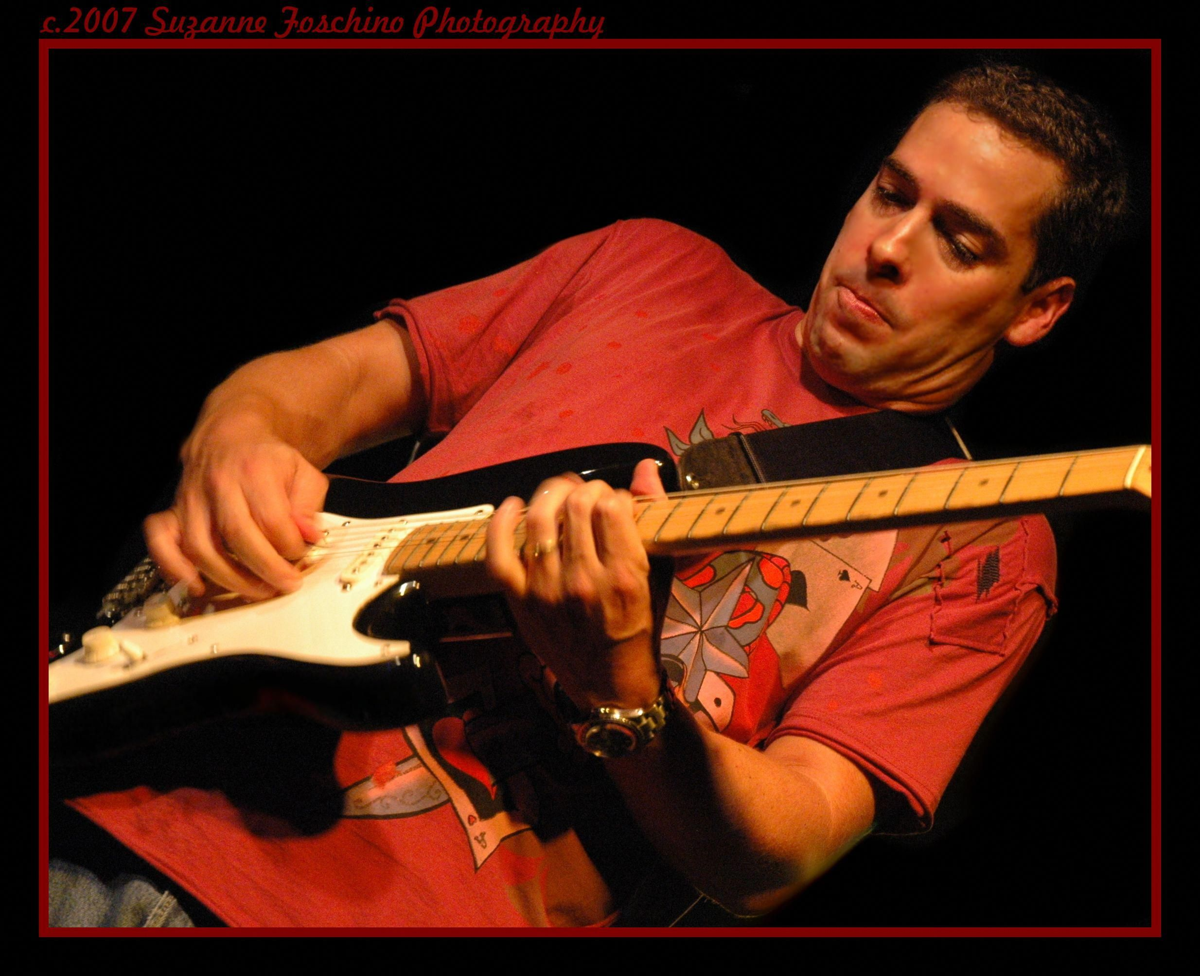 Learn to play the acoustic electric guitar making use of