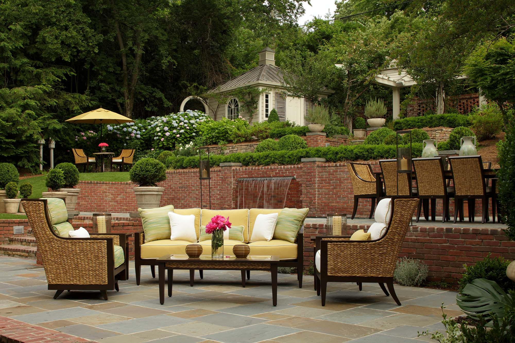 Patio furniture set made of resin wicker and wrought aluminum