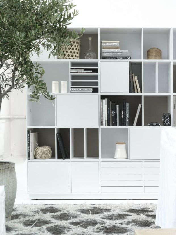 bright white and functional built in joinery for the living room ...