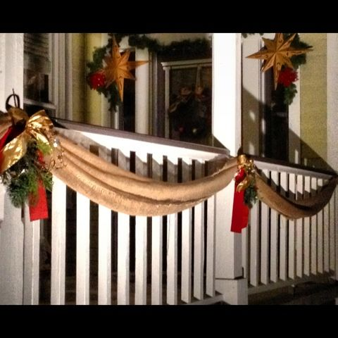 Great outdoor Christmas decor using draped burlap instead of garland
