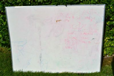 Have one of these hiding in your garage? How to Clean a Dry Erase White Board and update the look!