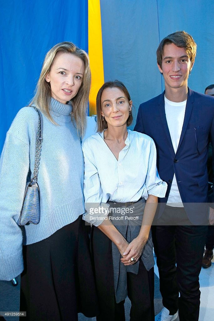 Fashion Designer Phoebe Philo standing between Alexandre Arnault (R) and his sister, Louis Vuitton's executive vice president, Delphine Arnault (L) pose after the Celine show as part of the Paris Fashion Week Womenswear Spring/Summer 2016 on October 4, 2015 in Paris, France.