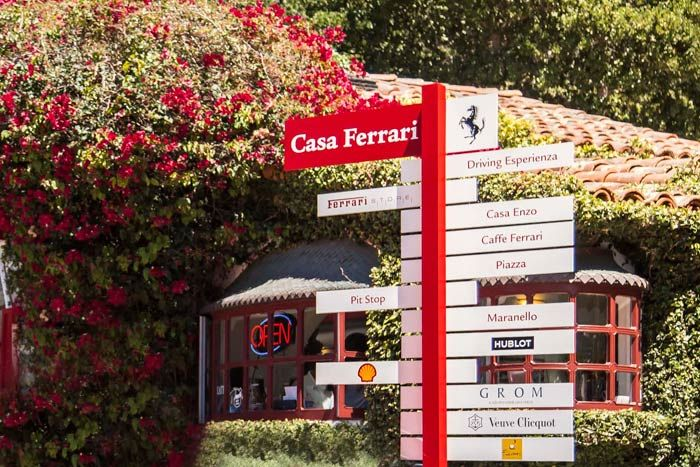 "Custom signage erected at the entrance to the gas station directed guests to either the public areas on the left or the by-invitation-only sections to the right. The verbiage was a riff on Ferrari's Maranello, Italy, headquarters that also indicated its partner vendors for the pop-up. ""The most important element about Casa Ferrari was that it have a public area,"" said Adams. ""The public space balanced the private space and it was important to give as much a Ferrari experience to the motor…"
