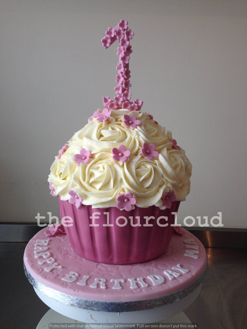 Pink Flowers On The 1st Birthday Giant Cupcake Childrens Cakes