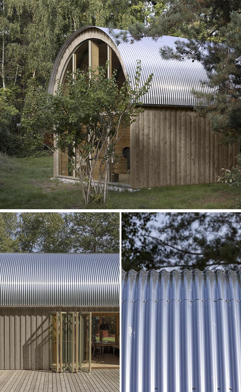 A Curved Corrugated Metal Roof Creates An Impressive Vaulted Ceiling Inside This Cabin In 2020 Metal Roof Corrugated Metal Corrugated Metal Roof