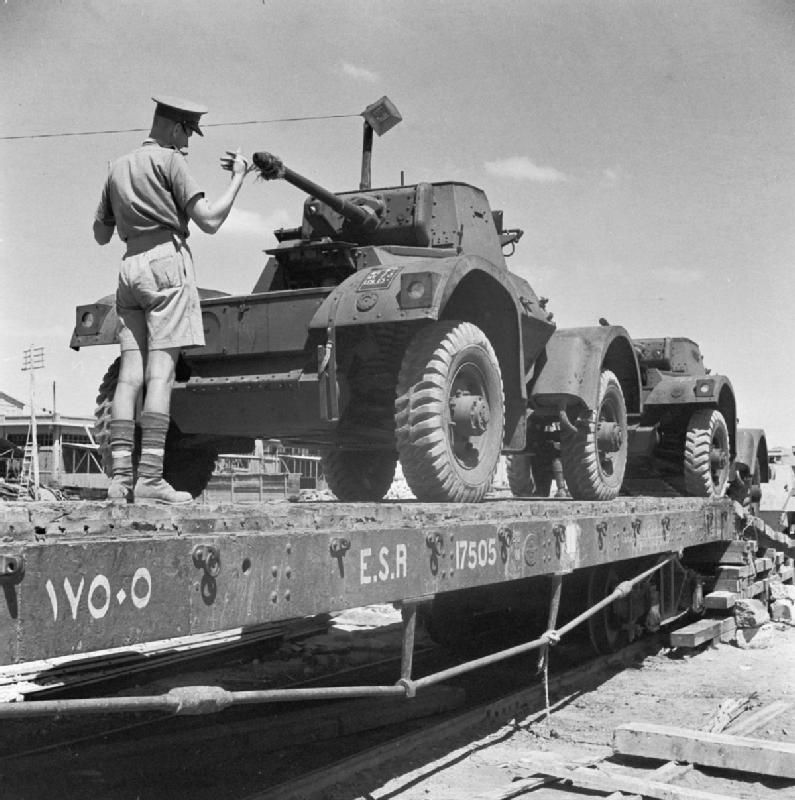 BRITISH ARMY NORTH AFRICA 1942 (E 14129)   Newly-arrived Daimler armoured cars being loaded aboard railway flatcars at Port Tewfik, Egypt, 10 July 1942.
