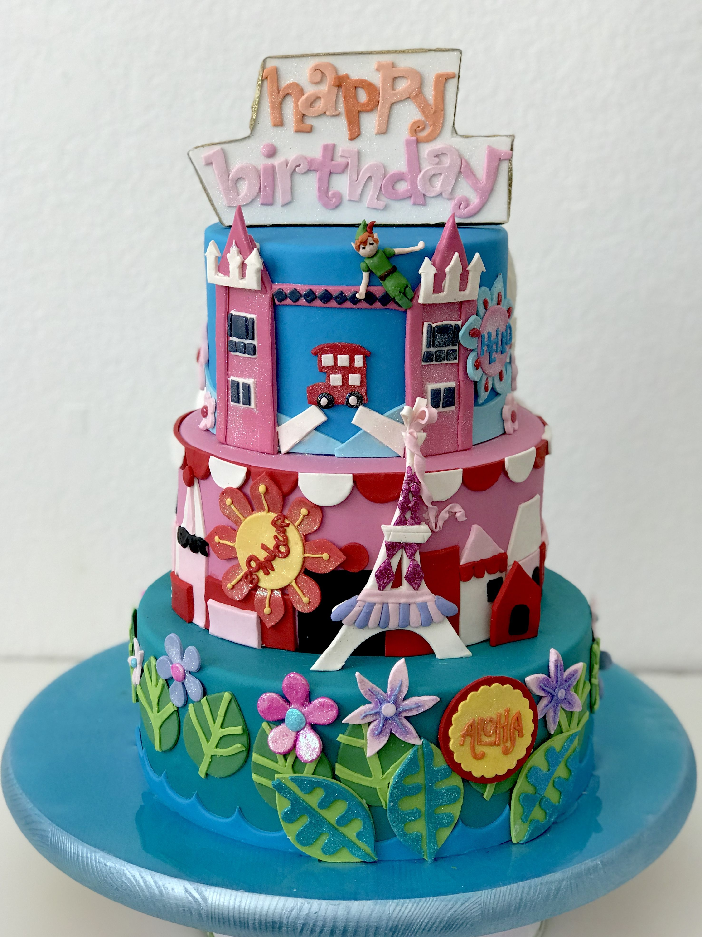 Its a small world double sided cake by paris custom cakes
