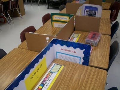 Removable desk dividers made out of used science fair project boards; perfect for test-taking!