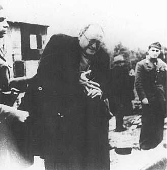 Ustasa (Croatian fascist) camp guards order a Jewish man to remove his ring before being shot. Jasenovac concentration camp, Yugoslavia, between 1941 and 1945.  — Jewish Historical Museum of Yugoslavia