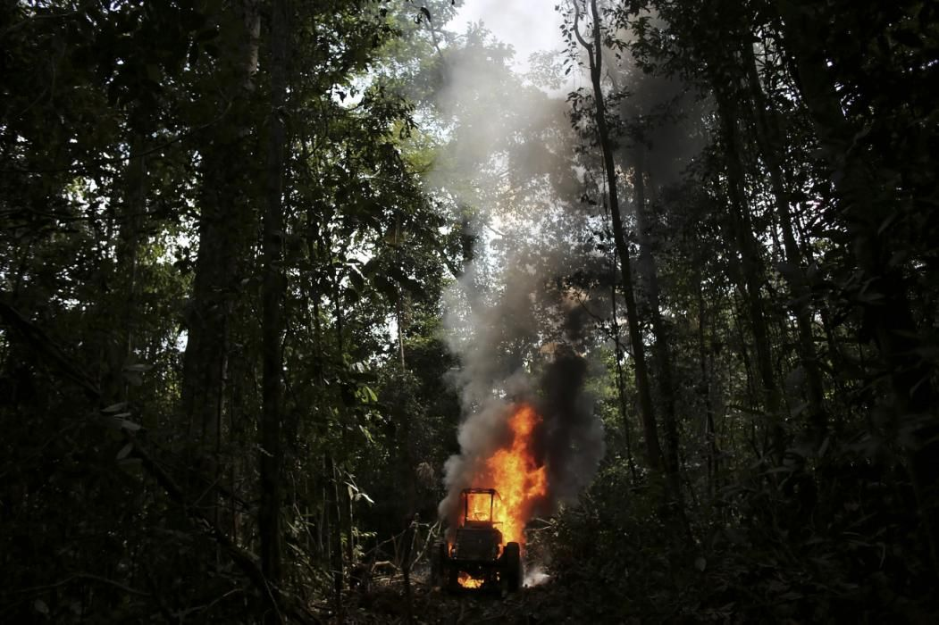A Tractor Used To Drag Logs Out Of The Amazon Rainforest Burns