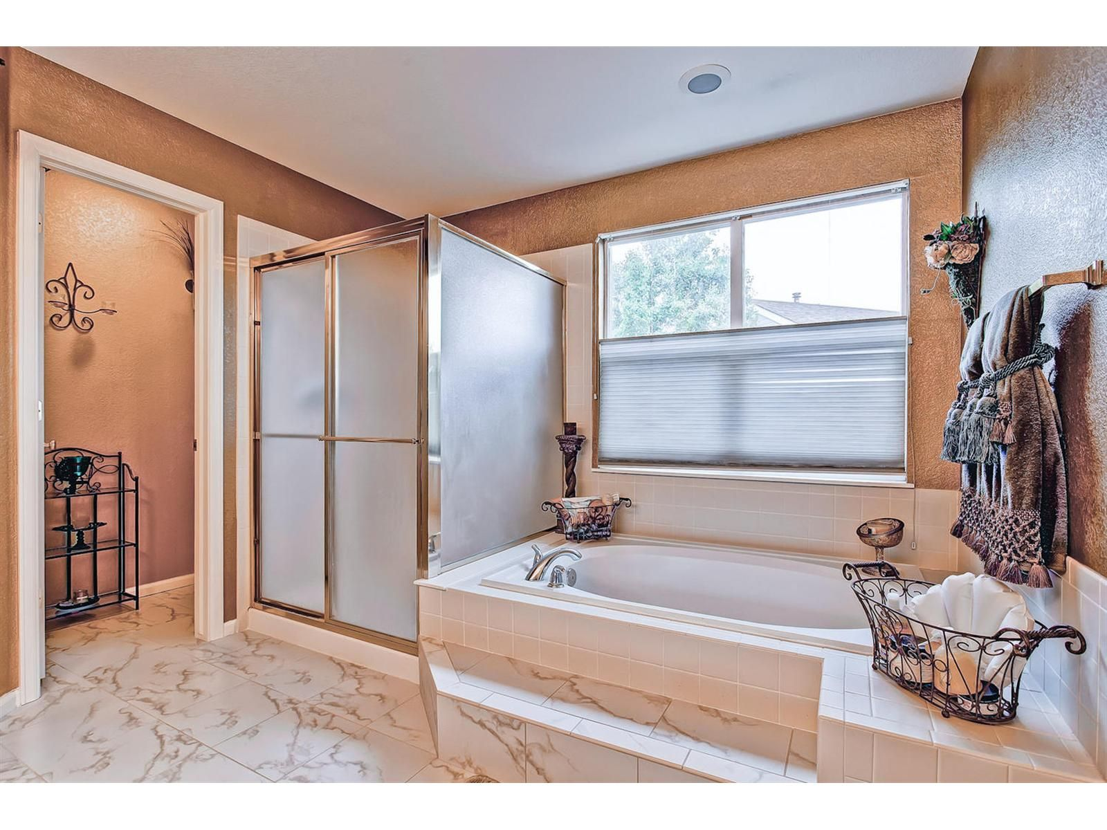 On suite master bathroom with tub, stand up shower, double ...