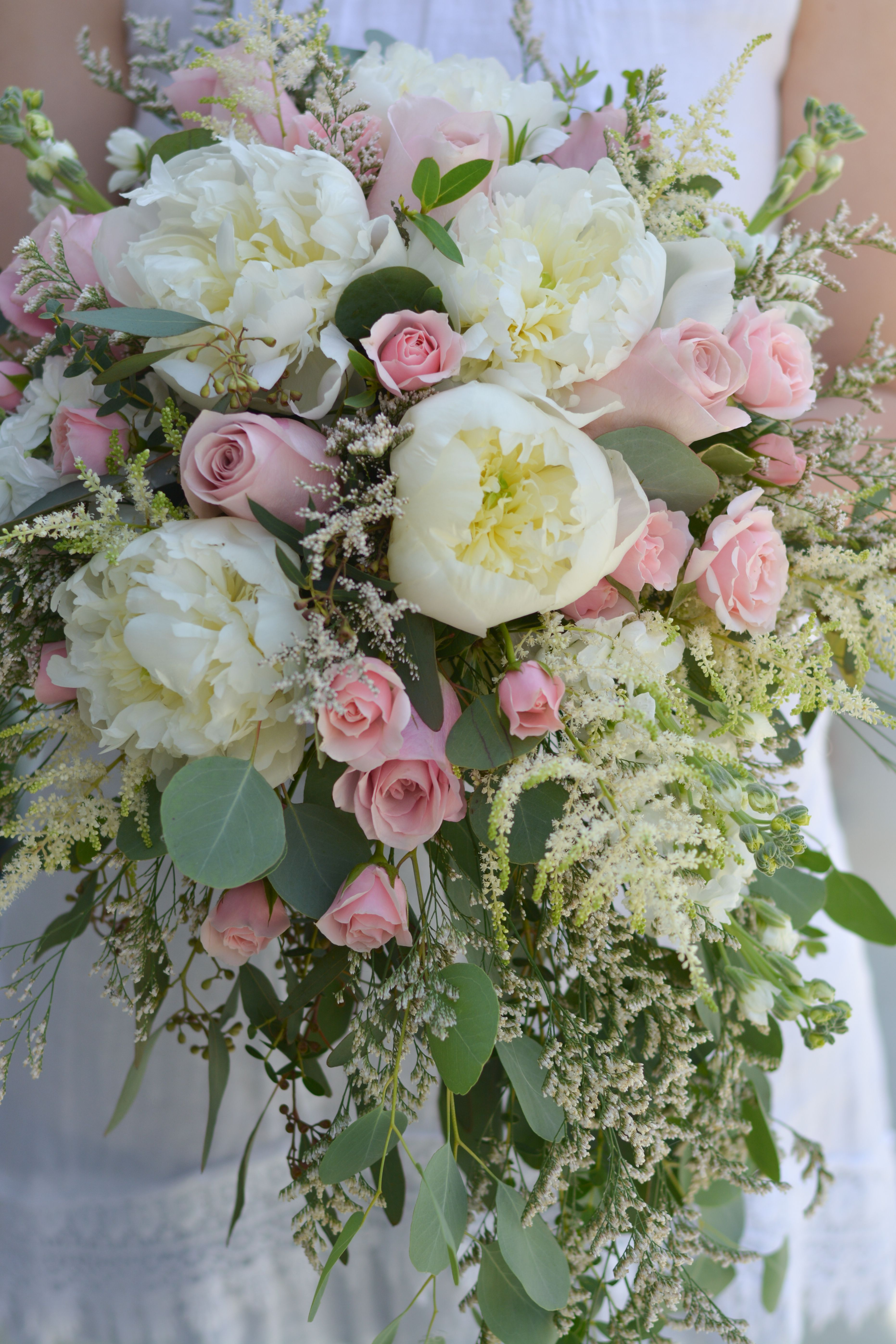 Exquisite pink and white cascade bouquet peonies