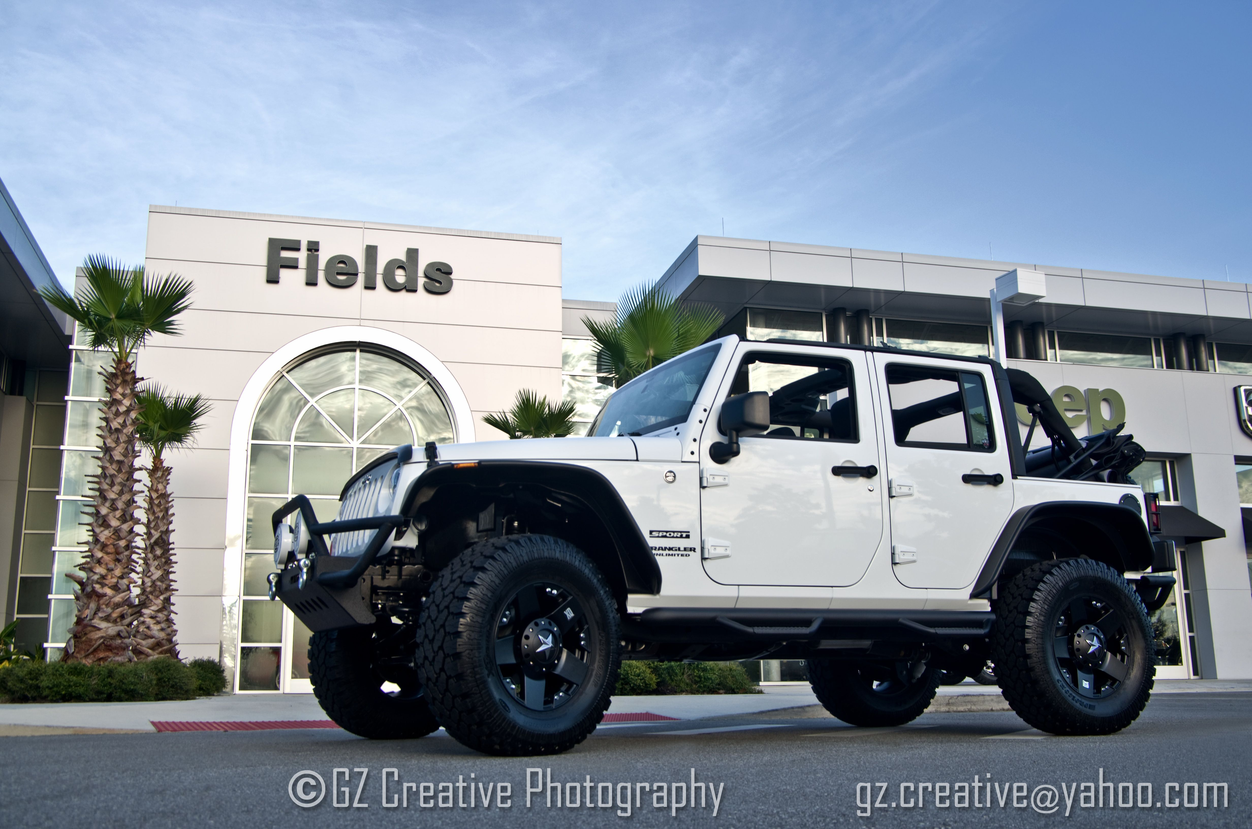 A 2 door jeep wrangler sport after our jam werks florida team customized it at