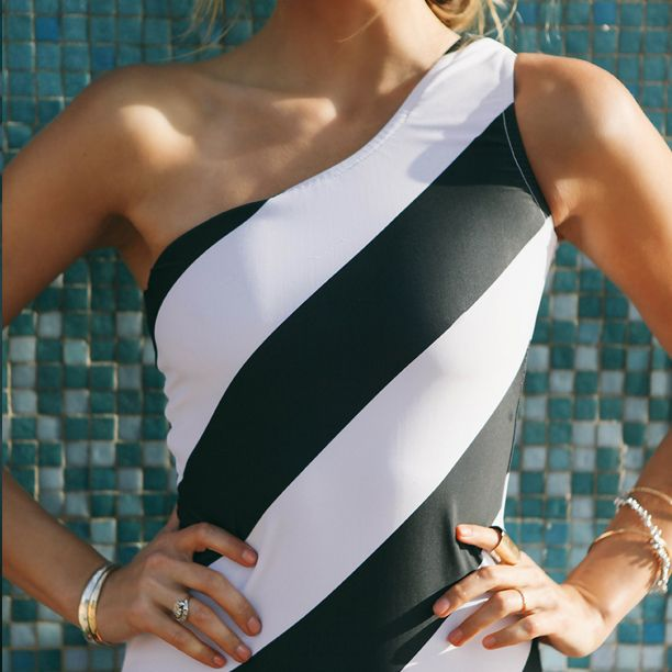 Black and White Bombshell: the iconic Wait Until Dark swimsuit from Albion is asymmetrical-amazing! The black and white stripes, shapely fit, and bold pattern make it a statement suit for the sand or swimming pool.