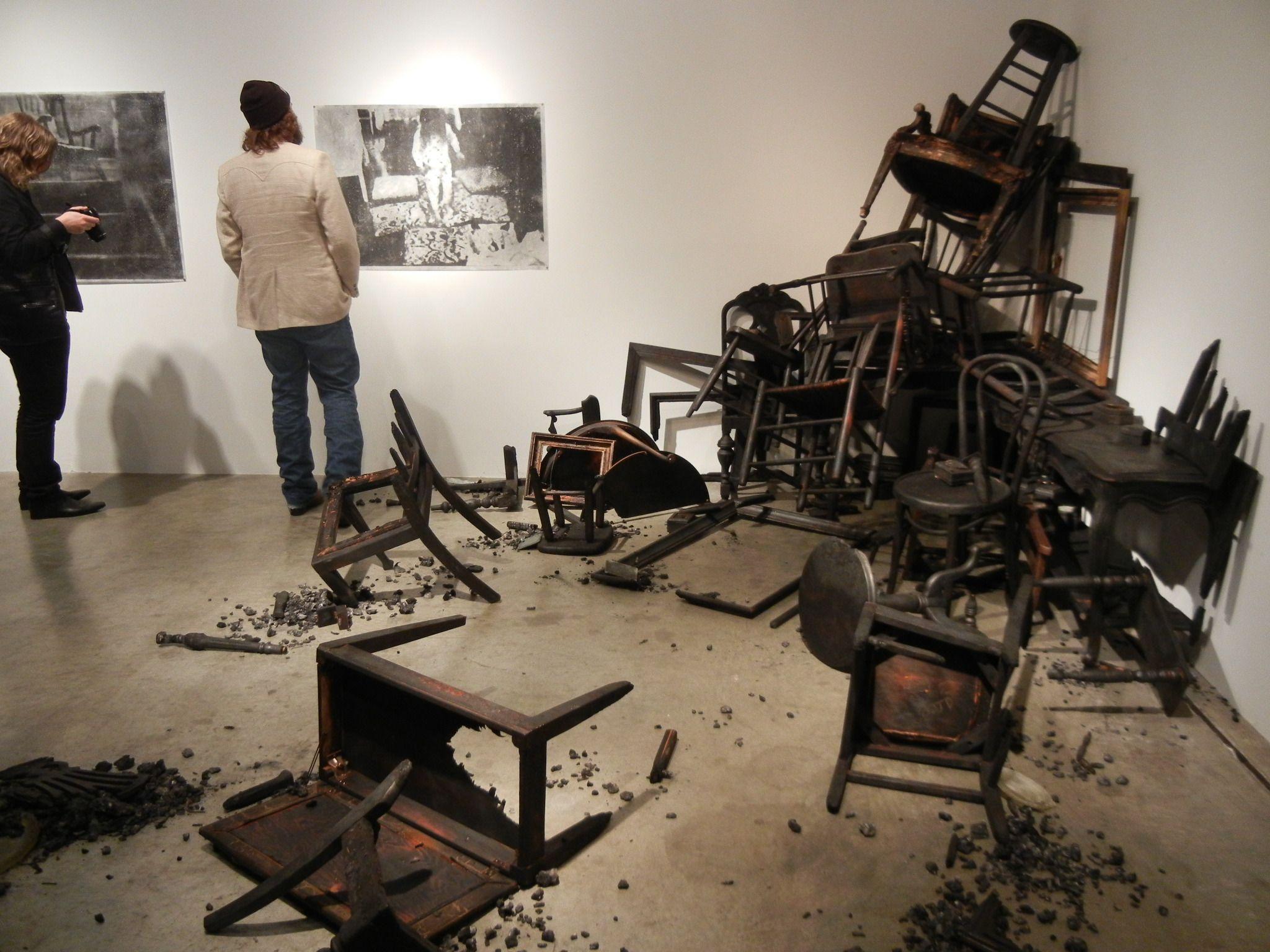 pile of burnt furniture