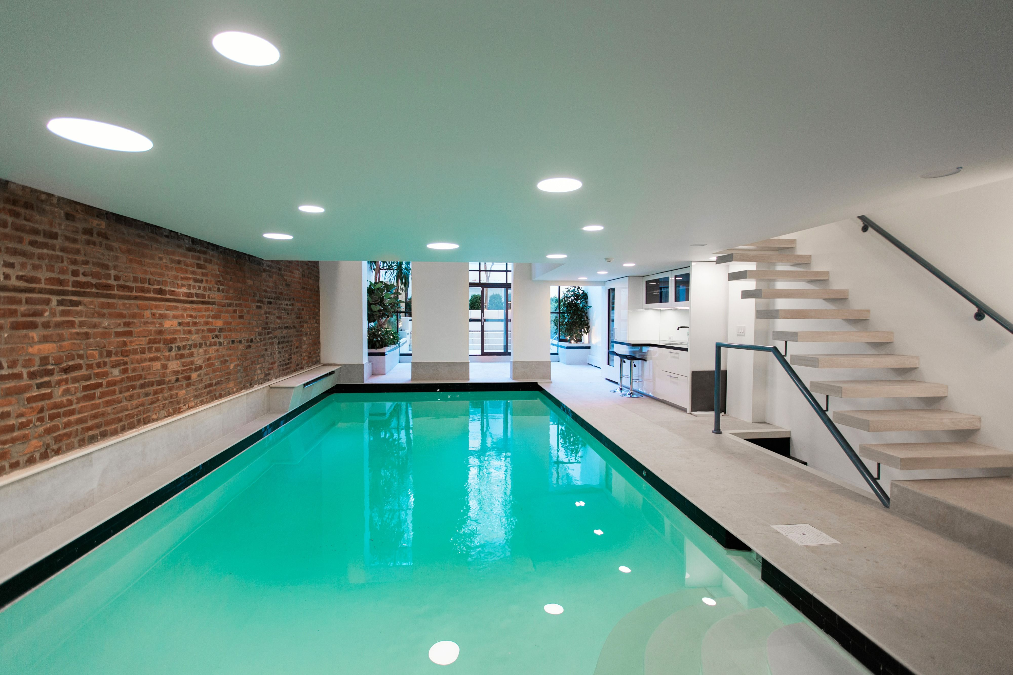 This luxurious residence has an indoor heated pool with