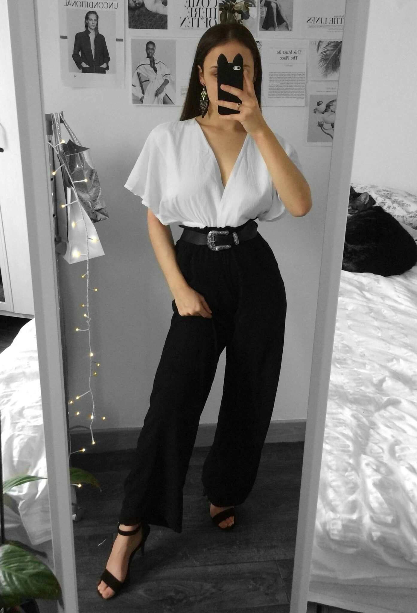 Loose wrap top with flared sleeves a high waisted belted but loose pants.  Belt style. Ankle strapped heels. 0bc77c1e1