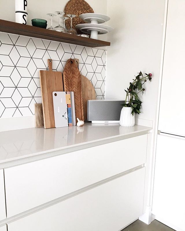 white matte kitchen with geometric cube tiles  styling