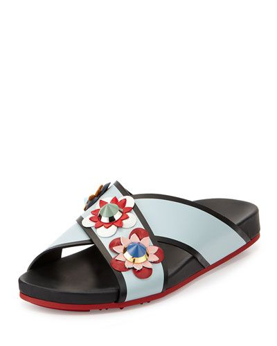 "Fendi multicolor calf leather sport sandal. Floral appliqu with enameled metallic studs. 1"" covered flat heel. Open toe. Crisscross vamp. Slide-on style. Rubber outsole. ""Flowerland"" is made in Italy."
