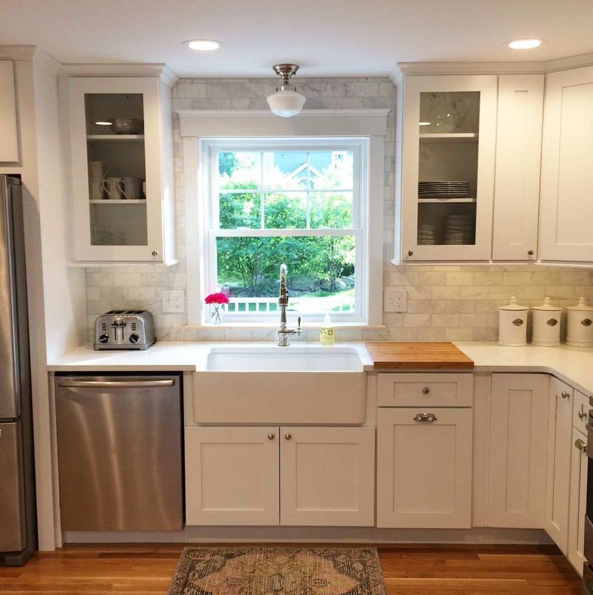 A gorgeous kitchen featuring a Kohler Artifacts faucet and Blanco ...