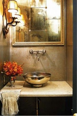 """Barry Dixon designed this small but chic powder bathroom.  We love the detailed """"antiqued"""" framed mirror and custom limestone vanity.  And something a simple as FRESH flowers makes all the difference."""
