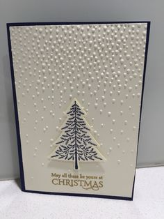 """Stampin' Up! Elegant Christmas card using Softly falling embossing folder with """"Peaceful pines"""" and """"Versatile Christmas"""" stamp sets with coordinating Night of Navy card stock and ink, Vanilla card stock and gold embossing powder."""