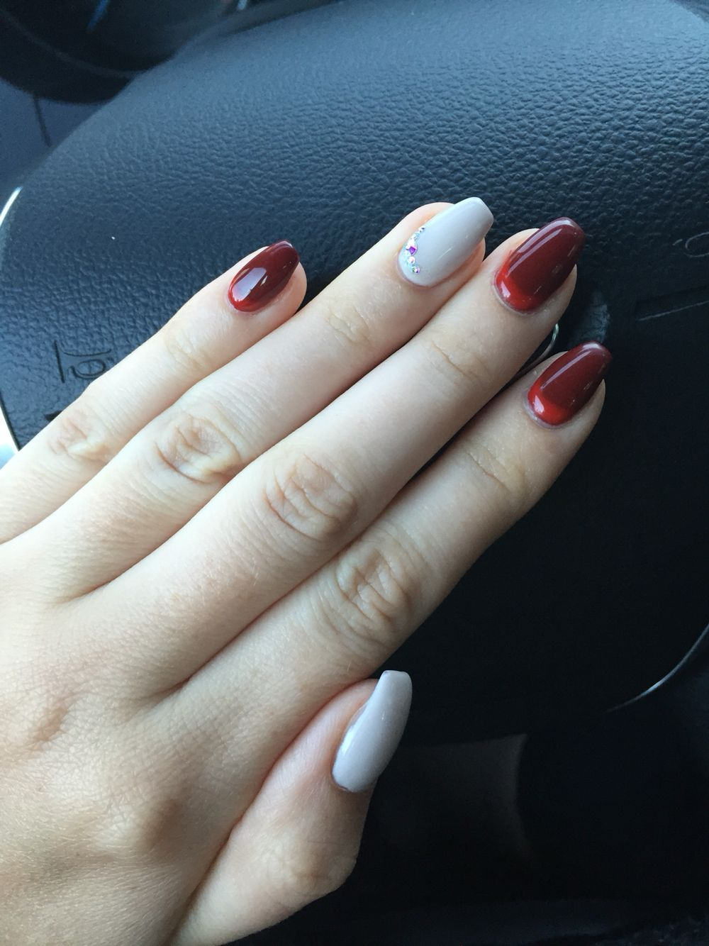 Fire red cuticles and dark red with nude accent nails, coffin style ...